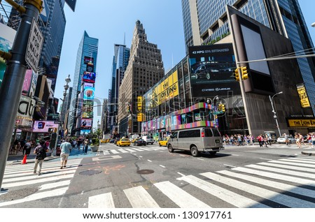 NEW YORK CITY - JULY 12: Undefined people pass through Times Square on July 12, 2012 in New York. Times Square is a major commercial intersection at the junction of Broadway and Seventh Avenue. - stock photo