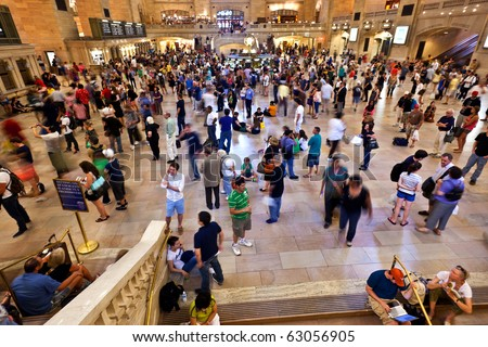 NEW YORK CITY- JULY 10 :  view of commuters and tourists flood the grand central station during the afternoon rush hour July 10, 2010 in New York. - stock photo