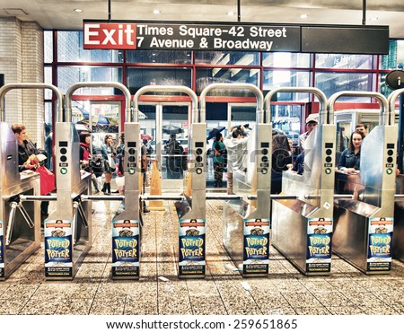 NEW YORK CITY - JUN 13, 2013: Entrance to NYC subway station. Owned by the NY City Transit Authority, the subway has 469 stations in operation.