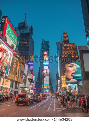 NEW YORK CITY - JUN 13: Lights of Times Square in the evening, June 13, 2013 in NYC. Formerly Longacre Square, Times Square was renamed in April 1904 after The New York Times moved its headquarters. - stock photo