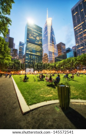 NEW YORK CITY - JUN 8: People relax in Bryant park in the evening, June 8, 2013 in NYC. Bryant Park is a 9,603 acre privately managed park in the center of Manhattan - stock photo