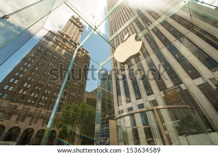 NEW YORK CITY - JUN 12: The iconic Apple Store on Fifth Avenue, June 12, 2013 in NYC. The store in it self is all underground except for the 32-foot glass cube right in front of f the GM building. - stock photo