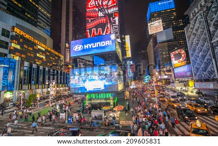NEW YORK CITY - JUN 8: Times Square, featured with Broadway Theaters and animated LED signs, is a symbol of New York City and the United States, June 8, 2013 in Manhattan, New York City..