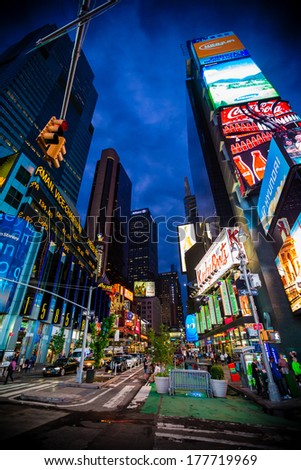 NEW YORK CITY - JUN 3: Times Square, is a busy tourist intersection of neon art and commerce and is an iconic street of New York City and America, Jun 3th, 2013 in Manhattan, New York City. - stock photo