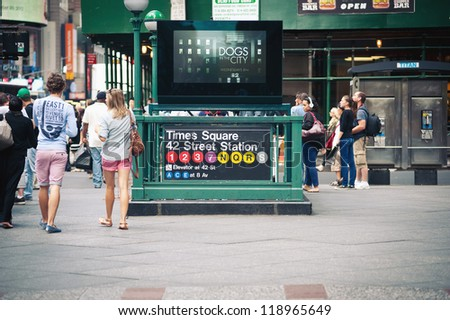 NEW YORK CITY - JUN 26: Times square subway station in NYC on June 26, 2012. Times square is a busy tourist intersection of commerce Advertisements and a famous street of New York City and US. - stock photo