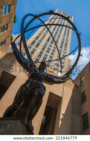 NEW YORK CITY - JUNE 17, 2014: Atlas statue in front of Rockefeller Center. The sculpture depicts the Ancient Greek Titan Atlas holding the heavens. It was created by sculptor Lee Lawrie. - stock photo