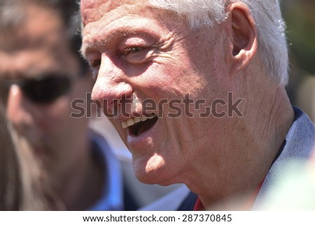 NEW YORK CITY - JUNE 13 2015: Bill Clinton supports his wife and former secretary of state Hillary Rodham Clinton as she formally announces her intention to seek the 2016 Democratic nomination for president during a rally on Roosevelt Island - stock photo