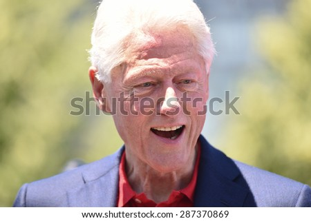 NEW YORK CITY - JUNE 13 2015:Bill Clinton supports his wife and former secretary of state Hillary Rodham Clinton as she formally announces her intention to seek the 2016 Democratic nomination for president during a rally on Roosevelt Island - stock photo