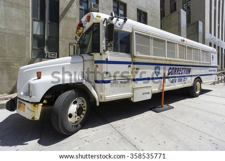 NEW YORK CITY- JUNE 13, 2015: Correction Department bus parked in front of New York City Criminal Court - stock photo