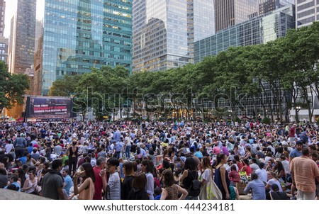 NEW YORK CITY - June 20, 2016 - Crowds gather at Bryant Park for the Summer Film Festival - MANHATTAN, NEW YORK  - stock photo