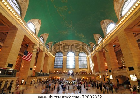 NEW YORK CITY - JUNE 23: Inside the historic Grand Central Station Terminal travelers check their bags, buy tickets, and head towards their next destinations June 23, 2010 in New York, New York. - stock photo