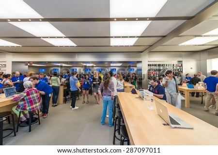 NEW YORK CITY - JUNE 12, 2013: Interior of famous Apple Fifth Avenue shop. The company has more than 400 shops worldwide. - stock photo