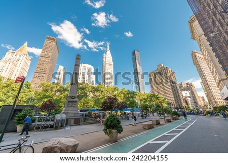 NEW YORK CITY - JUNE 12, 2013: Locals and tourists walk along city streets. New York attracts more than 50 million people annually. - stock photo
