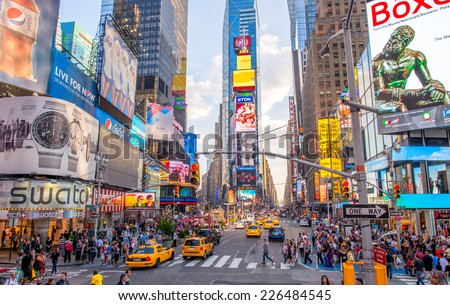 NEW YORK CITY - JUNE 15, 2013: Locals and tourists walk in Times Square. More than 50 million people visit New York every year. - stock photo