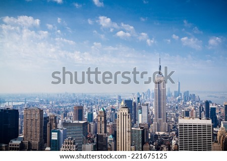 NEW YORK CITY - JUNE 17, 2014: Lower Manhattan skyline on hazy morning. Manhattan has been described as the economic and cultural center of the United States. - stock photo