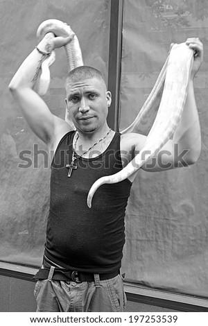 New york city june 30 man holding his snake at the nyc lgbt gay