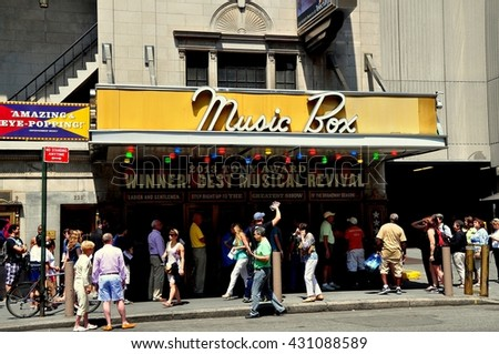 "New York City - June 29, 2013:  People waiting to buy tickets to the smash hit musical ""Pippin"" at the Music Box Theatre on West 45th Street"