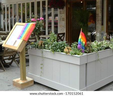 NEW YORK CITY - JUNE 27: Restaurant in Manhattan welcomes customers of 43rd annual Pride Parade on June 27, 2013  - stock photo
