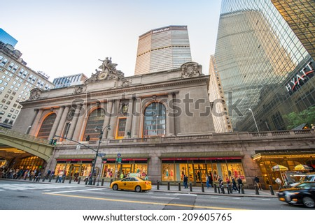 NEW YORK CITY - JUNE 8, 2013: Rush of pedestrians outside historic Grand Central Terminal in NYC. The world's largest train station, Grand Central has more than 44 platforms and 67 tracks - stock photo