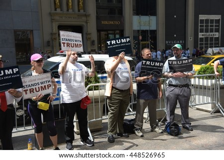 NEW YORK CITY - JUNE 25 2016: Several dozen supporters of presumptive Republican  nominee Donald Trump gathered in front of Trump Tower to voice their support for the billionaire developer. - stock photo