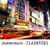 NEW YORK CITY - JUNE 28th, 2014: Times Square, famous tourist attraction featured with Broadway Theaters and famous restaurant and store locations in New York City, June 28, 2014 in Manhattan, NYC. - stock photo