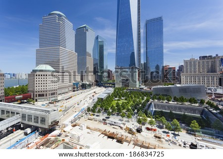 New York City - June 23: The almost finished One World Trade Center and memorial site in New York with blue sky  on June 23, 2013 - stock photo
