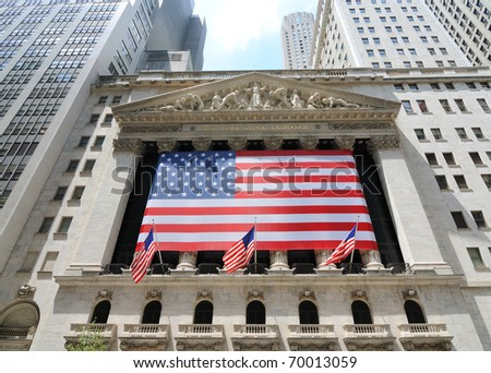 NEW YORK CITY - JUNE 4: The historic New York Stock Exchange on Wall Street with crowds below, one of the largest stock exchanges in the world June 4, 2010 in New York, New York. - stock photo