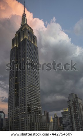 New York City - June 21 - The iconic Empire State Building at dusk with dramatic clouds.  Manhattan, New York, June 21, 2016 - stock photo