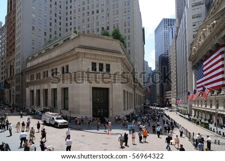 NEW YORK CITY - JUNE 4: The intersection of Broad Street and Wall Street including landmark buildings of the New York Stock Exchange and the House of Morgan June 4, 2010 in New York, New York. - stock photo