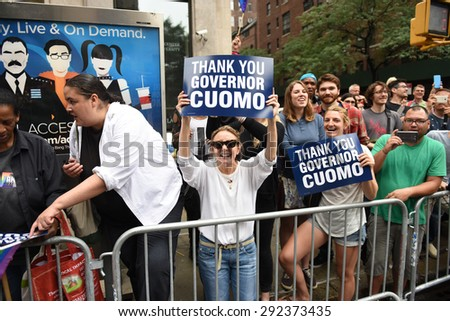 NEW YORK CITY - JUNE 28 2015: the 45th annual LGBT Pride parade drew an estimated two million spectators buoyed by the Supreme Court's Obergefell ruling on same sex marriage. Pro Cuomo signs