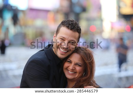 NEW YORK CITY - JUNE 7 2015: the 69th annual Tony Awards ceremony was held at Radio City Music Hall along with a simulcast in Times Square. Justin Guarini with fan - stock photo