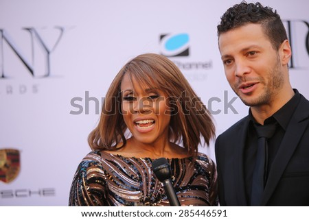 NEW YORK CITY - JUNE 7 2015: the 69th annual Tony Awards ceremony was held at Radio City Music Hall along with a simulcast in Times Square. Justin Guarini & Deborah Cox, - stock photo