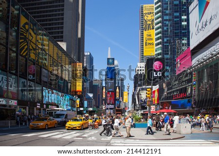 NEW YORK CITY - June 9: Times Square, is a busy tourist intersection of neon art and commerce and is an iconicplace of New York City and USA on JUNE 9, 2014 in Manhattan, New York City.