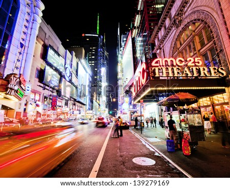 NEW YORK CITY - JUNE 3: Times Square is a busy tourist intersection of neon art and commerce and is an iconic street of New York City and America, June 3rd, 2012 in Manhattan, New York City. - stock photo