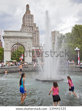 NEW YORK CITY - June 6: Washington Square Park June 3rd, 2012 in New York, NY. The park is known for Washington Arch which was built to commemorate the centennial of George Washington. - stock photo
