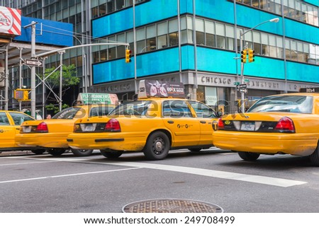 NEW YORK CITY - JUNE 11, 2013: Yellow cabs speed up in Manhattan. More than 13,000 taxis run in New York City. - stock photo