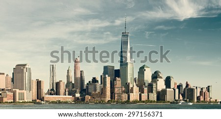 New York City lower Manhattan financial  wall street district buildings skyline on a beautiful summer day filtered instagram vintage desaturated looks - stock photo