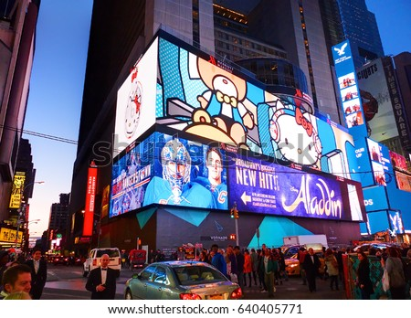 NEW YORK CITY, MANHATTAN, APR,24, 2015: Evening view on NYC Times Square lights screens buildings fashion boutiques led billboards skyscrapers architecture. Led screens advertising billboards