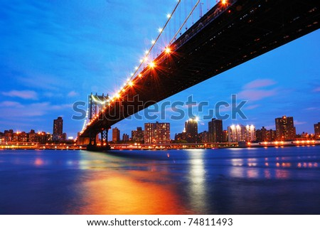 New York City Manhattan bridge and Manhattan skyline at dusk.