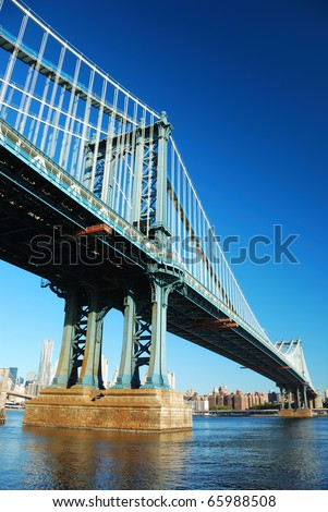 New York City Manhattan Bridge with skyscraper skyline in the morning over east Hudson River. - stock photo