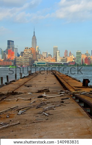 New York City, Manhattan buildings view from the Harbor on Hudson river, with blue sky and clouds - stock photo