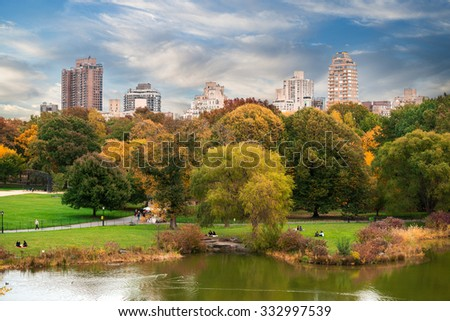 New York City Manhattan Central Park panorama with autumn lake with skyscrapers and colorful trees.