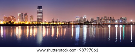 New York City Manhattan downtown skyline and New Jersey at night panorama