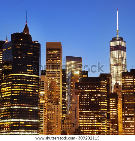 New York City Manhattan downtown skyline at night with illuminated skyscrapers - stock photo