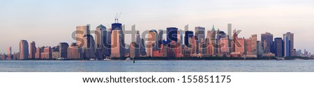 New York City Manhattan downtown skyline at sunset over Hudson River panorama - stock photo