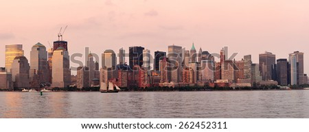 New York City Manhattan downtown skyline at sunset over Hudson River panorama - stock photo