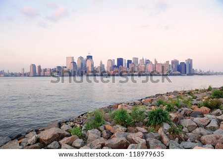 New York City Manhattan downtown skyline at sunset over Hudson River panorama viewed from New Jersey shore - stock photo