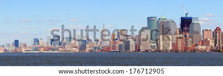 New York City Manhattan downtown skyline panorama view with Empire State Building and skyscrapers with blue clear sky over river