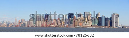 New York City Manhattan downtown skyline panorama view with Empire State Building and skyscrapers with blue clear sky over river - stock photo