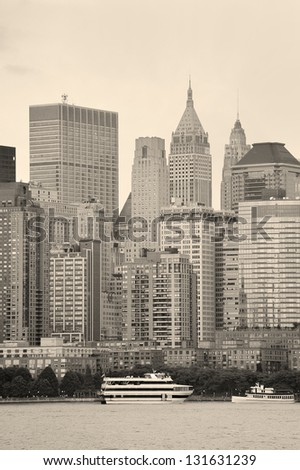 New York City Manhattan downtown skyline with boat at sunset over Hudson River panorama black and white - stock photo
